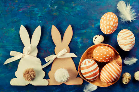 traditional celebrations: Two Easter bunny and  easter eggs on a blue background
