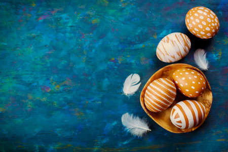 Painted colorful easter eggs on a blue background