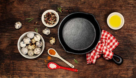 Ingredients for cooking eggs and empty iron skillet