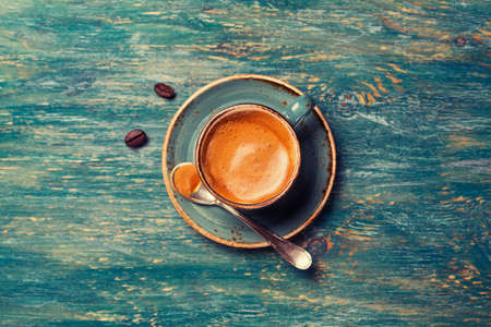 'retro styled': Espresso in a blue bowl with a spoon, top view Stock Photo