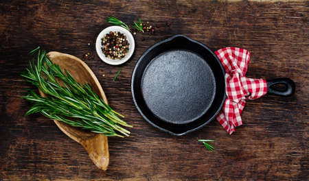 Ingredients for cooking and empty cast iron skillet