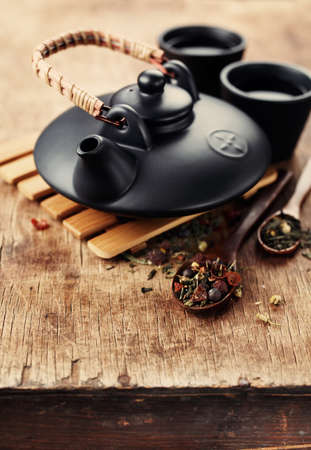 sencha tea: Chinese clay teapot and dry tea. Health and diet concept Stock Photo