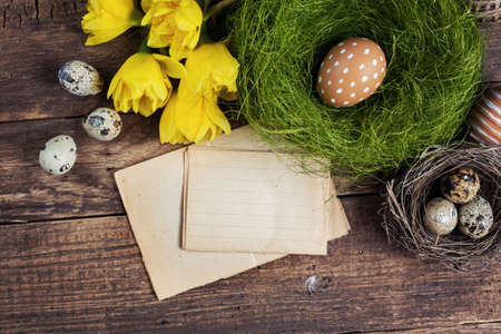 Brown speckled eggs and easter card on a wooden background photo