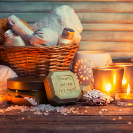 cpa: CPA still life, olive oil soap and candles on wooden table Stock Photo