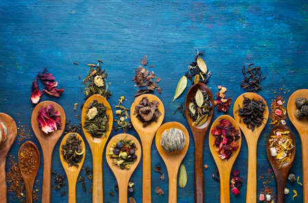 tea set: Dry tea with in wooden spoons. Top view Stock Photo