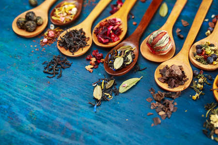 Various types of  tea with in wooden spoons.