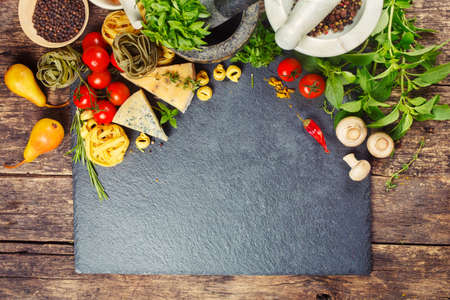 Italian food, pasta, cheese, vegetables and spices. Food background with copyspace Foto de archivo