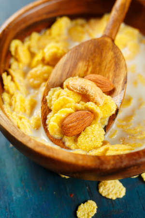 quick snack: Cornflakes with nuts close up. Selective focus