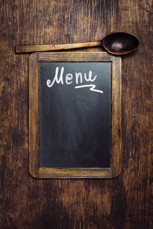 Small wooden framed blackboard with text - Menu.  Top view