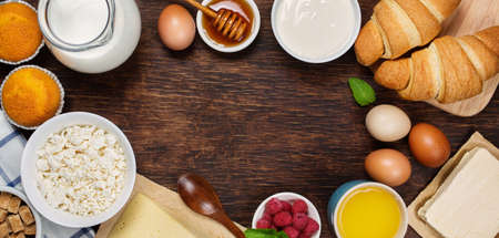 wood products: Healthy breakfast with natural dairy products. Top view, horizontal. Food background