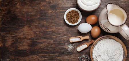 baking ingredients: Traditional baking ingredients. Rustic background with free text space. Stock Photo