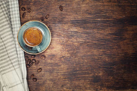 Coffee with crema on a rustic dark background