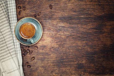 crema: Coffee with crema on a rustic dark background