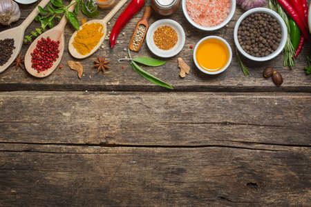 spices: Various spices on an old wooden table  with copyspace