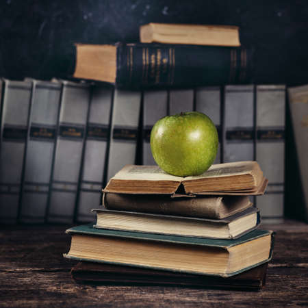 education background: Old books on a wooden table. Education background concept