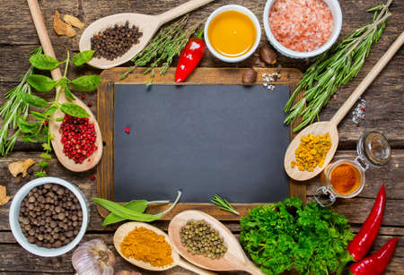 Various spices and Vintage blackboard with copyspace