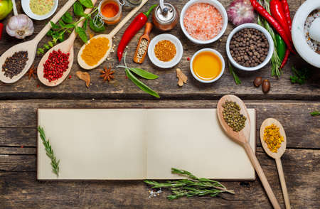 Blank book  recipes and various spices. Food background with copyspace 免版税图像