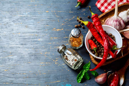 variety: Spices and hot pepper with copyspace,   on an old wooden table