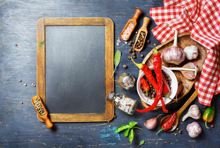 menu background: Spices and Vintage blackboard with copyspace. Food background Stock Photo