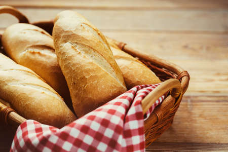 crust crusty: Fresh bread in  basket on a wooden table Stock Photo