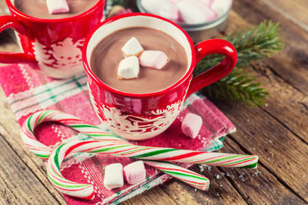 hot: Cup of hot chocolate with marshmallows on a wooden table Stock Photo