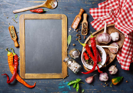 seasonings: Vintage blackboard and seasonings, top view. Food background concept with copyspace