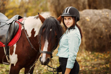 girl on horse: Young woman on countryside with horse for riding. Lifestyle concept