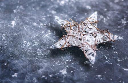 Christmas decoration. Christmas star on dark background. Selective focus