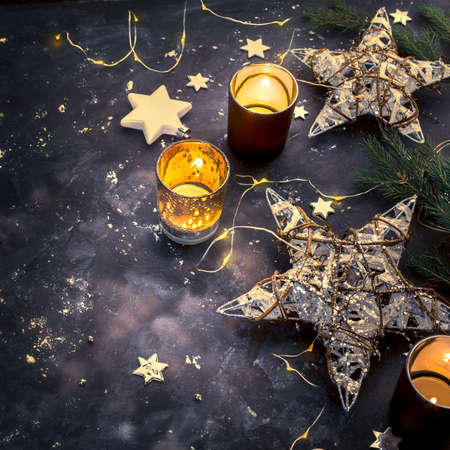 Christmas holiday decorations on dark background, top view