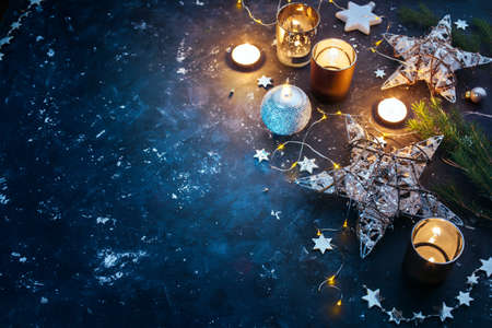 text: Christmas background with festive decoration, stars and candles. Christmas background with copyspace Stock Photo