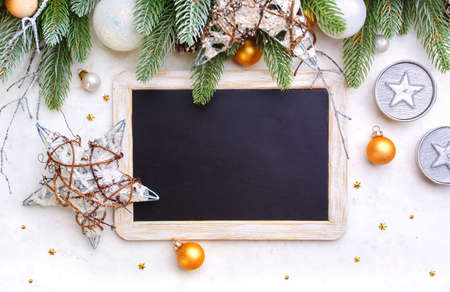 Christmas background  and blackboard with copyspace on a light background. Standard-Bild