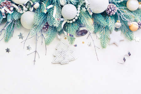Christmas Tree Pine Branches and Christmas balls on a light background. Christmas Holiday background with copyspace