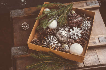ornamentals: Old Christmas ornamentals in the box. Christmas Holiday background.