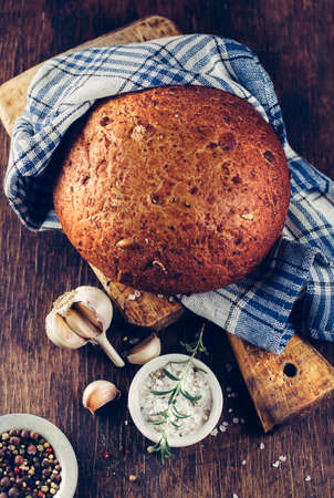 Traditional bread with spices. Still life in a rustic style. Shallow DOF Foto de archivo