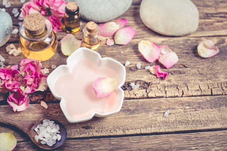 massage oil: Spa composition with sea salt, petals flowers and massage oil. Stock Photo
