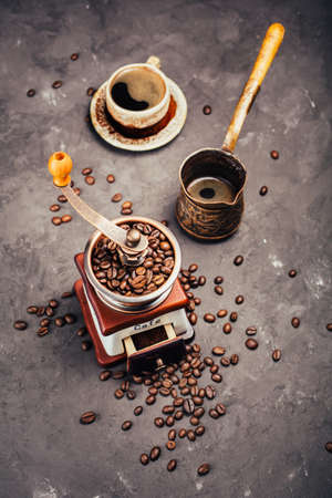 cezve: Grinder, cezve,  and a cup of freshly brewed coffee Stock Photo