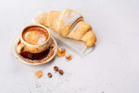 stimulant: Breakfast with coffee and croissants. Still life in a rustic style, top view. Shallow DOF