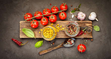 indian cookery: Spice and cherry tomatoes. Food background, Top view