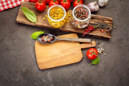 indian cookery: Spice for cooking and empty cutting board on an old wooden table. Food background with copyspace