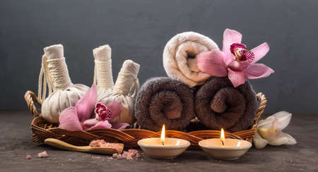 water concept: Spa concept with Thai herbal ball, sea salt, towels and candles Stock Photo
