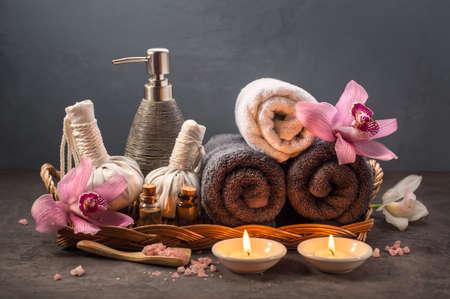spa flower: Beautiful SPA composition, Towels, sea salt, essential oil and a burning candles