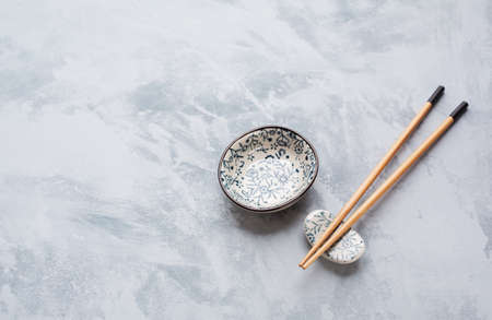 sauce bowl: Chopsticks and  sauce bowl  with copyspace. Japanese Cuisine Stock Photo