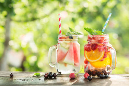Ice refreshing summer drink on blurred background.