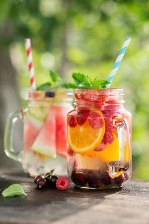 summer diet: Ice refreshing summer drink on blurred background. Healthy food, diet and cooking concept. Stock Photo