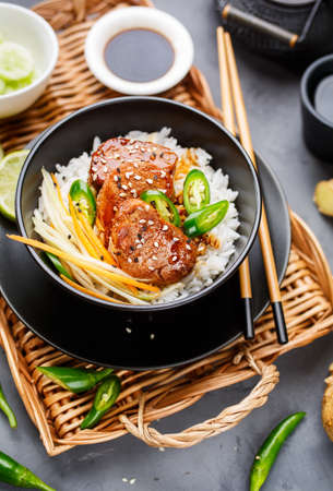 prepared dish: Asian food - roast meat with rice and vegetables. Food background