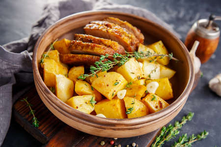 baked meat: Baked potatoes with meat, , plain rustic dish Stock Photo