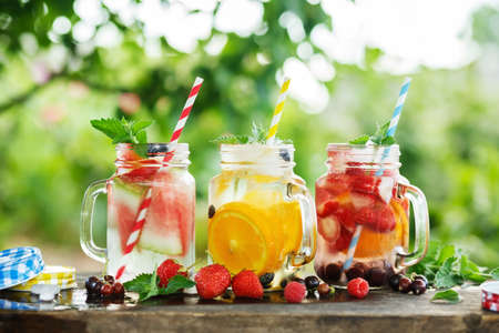 Ice refreshing summer drinks on blurred background. Stock Photo