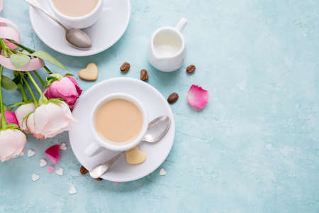 Coffee with cream and roses. Valentines Day background and free text space. Delicious Breakfast.