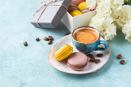 Cup of coffee with foam and macaroons. Valentines Day background or Womens day or Mothers day