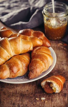 Fresh croissant on old wooden table, Selective focus, rustic 版權商用圖片